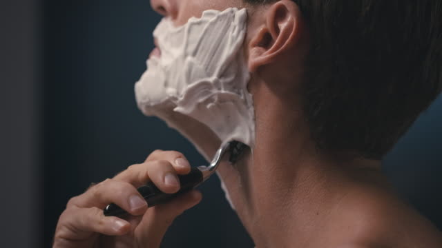 man shaving his face - beard stock videos & royalty-free footage