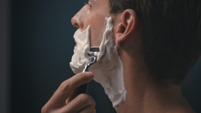 man shaving his face - domestic bathroom stock videos & royalty-free footage