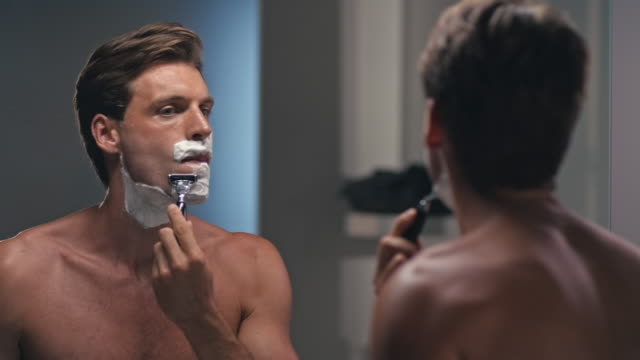 man shaving his face - shaving stock videos and b-roll footage