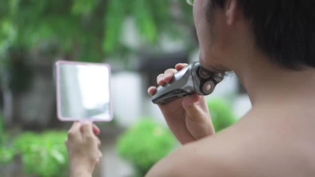 os man shaving his sideburn and beard - sideburn stock videos & royalty-free footage