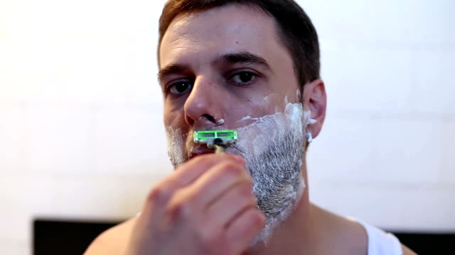 man shaving in front of bathroom mirror - shaving stock videos and b-roll footage