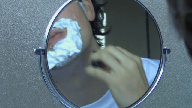 man shaving in mirror, uk - rasieren stock-videos und b-roll-filmmaterial