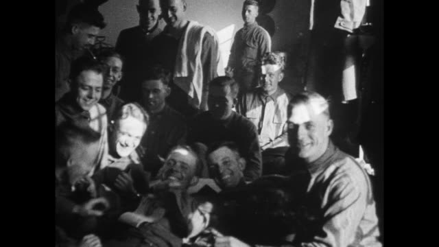 man shaving in the barracks men laughing as they sit around - shaving stock videos and b-roll footage