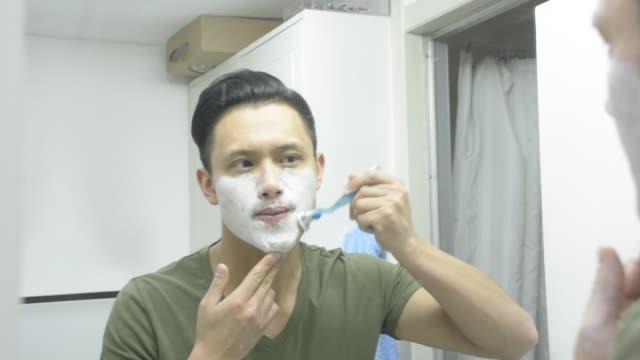 man shaving in toilet - razor stock videos & royalty-free footage