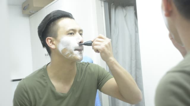 man shaving with electric device in toilet - electric razor stock videos & royalty-free footage