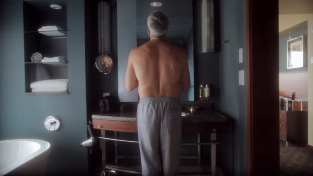 ms man shaving with razor in front of mirror / seattle, wa, united states - rasieren stock-videos und b-roll-filmmaterial