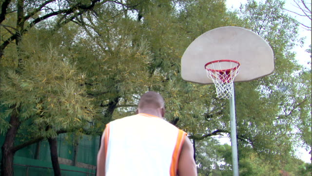 man shooting basketball into hoop - see other clips from this shoot 1281 stock videos and b-roll footage