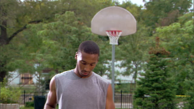 man shooting basketball - see other clips from this shoot 1281 stock videos and b-roll footage