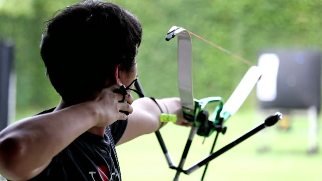 Man shooting bow.