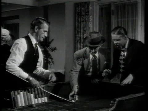 1948 MONTAGE Man shooting dice in craps game /