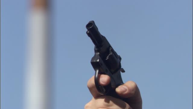 cu man shooting starting gun at beginning of race / sheffield, england, uk - 20 24 years stock videos & royalty-free footage