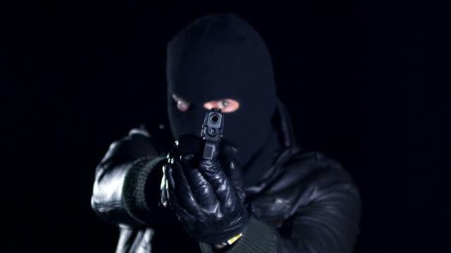 man shooting with gun - gun stock videos & royalty-free footage