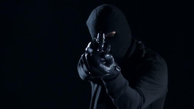 man shooting with gun - handgun stock videos & royalty-free footage