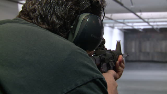 vídeos y material grabado en eventos de stock de wgn man shoots ar15 rifle at target on may 24 2018 - munición