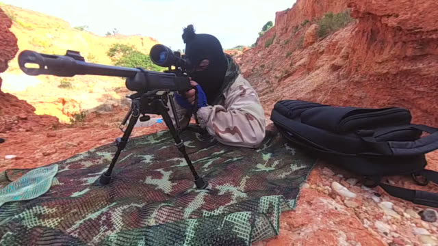 SWAT man shoots assault rifle, slow motion