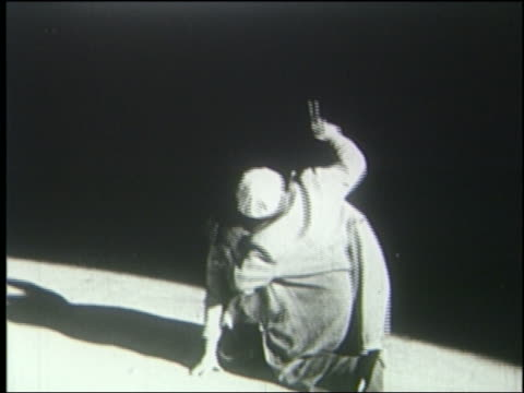 b/w 1925 man shoots gun upwards as dinosaur's foot comes down - 1925 stock videos & royalty-free footage