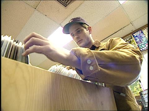 vídeos y material grabado en eventos de stock de man shopping for records - tienda de discos