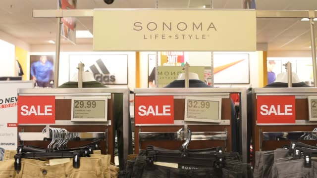 a man shops for clothing at a kohl's store in peoria illinois wide shot of a sonoma brand section of a kohl's department store in peoria illinois... - kohls stock videos & royalty-free footage