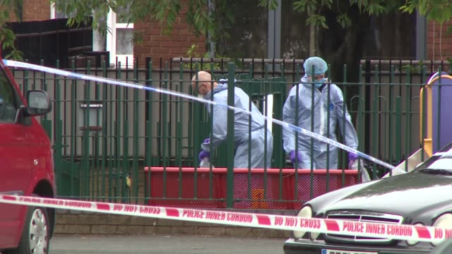 man shot close to pentonville prison: crime scene; england: london: islington: ext police cars and van / police officers standing guard in front of... - forensic science stock videos & royalty-free footage