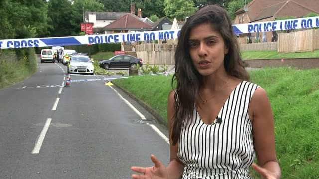 Man shot dead at a party in Headley near Epsom Reporter to camera Celia Stewart interview SOT Police cordon tape and traffic cones Empty bottle of...