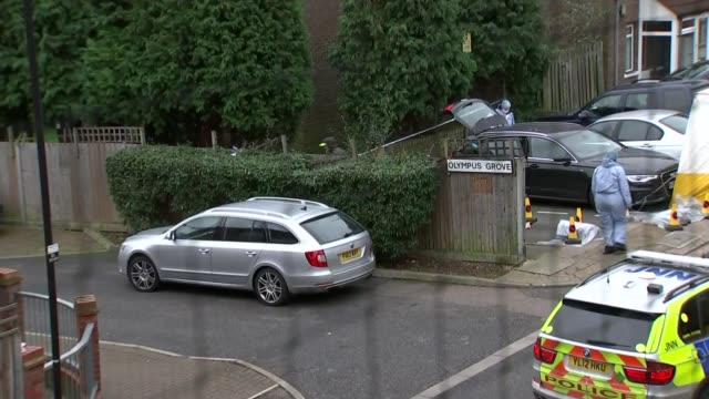 man shot dead by police during operation to prevent men being freed from custody england london wood green ext police officer taping off scene of... - black olive stock videos & royalty-free footage