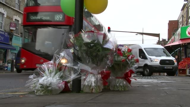 man shot dead in kilburn day ricky dustin interview sot flowers and balloons left at the scene of the shooting various of police officers searching... - medical resident stock videos and b-roll footage