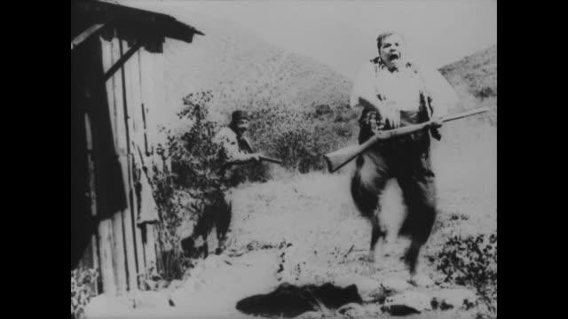 1918 man shot in butt (fatty arbuckle) kills the shooter (al st. john) - ヒルビリー点の映像素材/bロール