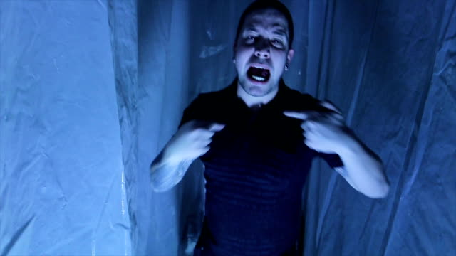 man shouting in a nylon covered room - claustrophobia stock videos and b-roll footage