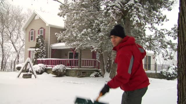 MS SLO MO Man shoveling driveway during snowstorm/ Hortonville, Wisconsin