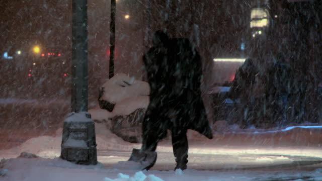 Man shoveling in heavy snow