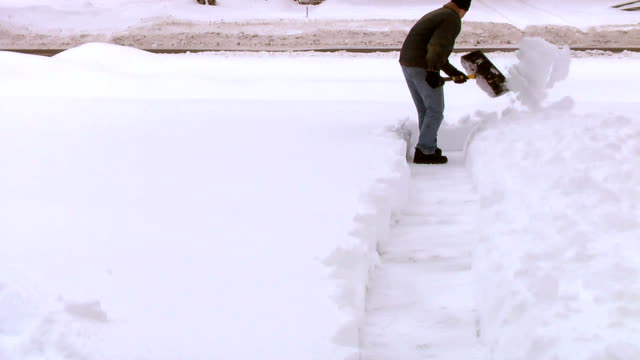 man shoveling snow from sidewalk - midwest usa stock videos & royalty-free footage