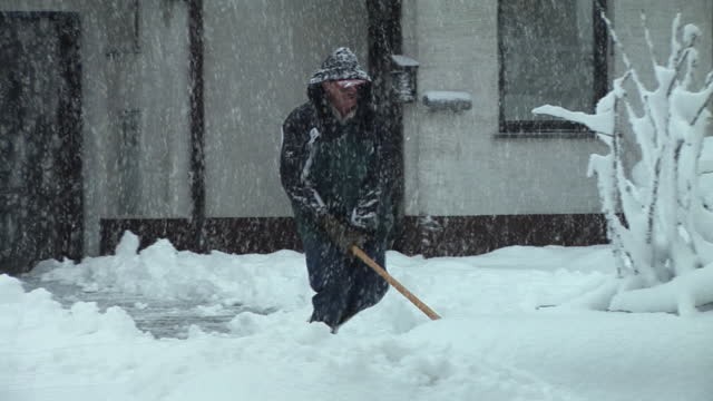 ws, pan, man shoveling snow on driveway, vrhnika, notranjska region, slovenia - digging stock videos and b-roll footage