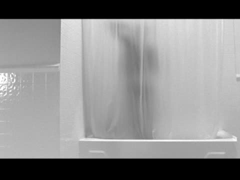 a man showers behind a sheer curtain - shower curtain stock videos and b-roll footage