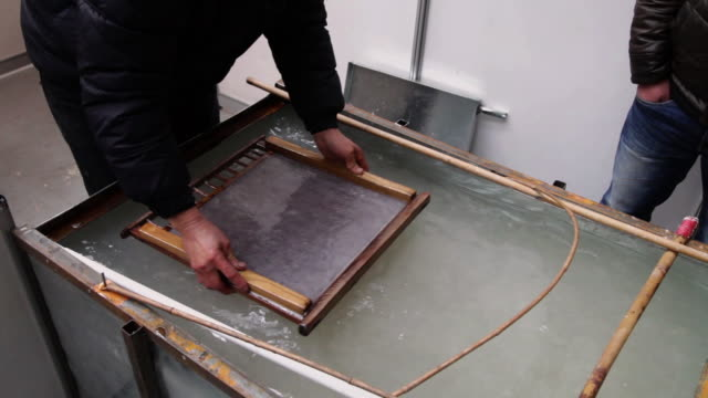ms ts man showing chinese ancient papermaking technology / xi'an, shaanxi, china - cartiera video stock e b–roll