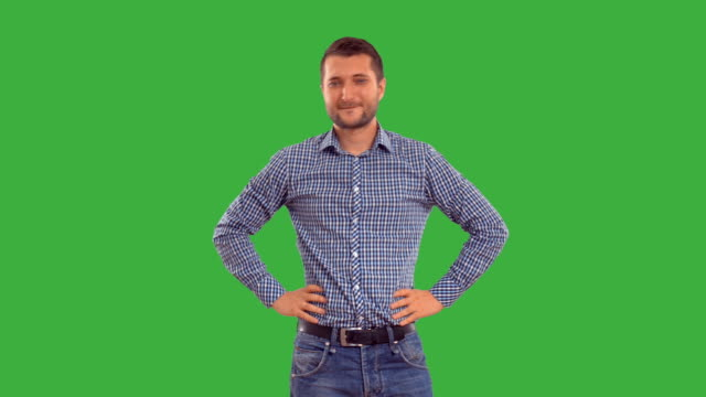 man showing copy space on  green background - plaid shirt stock videos & royalty-free footage
