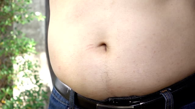 man showing his belly fat - navel stock videos & royalty-free footage