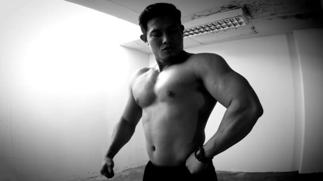 man showing his muscle - body building stock videos & royalty-free footage