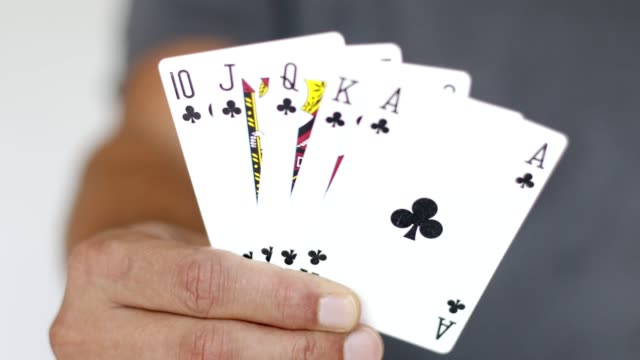 man showing poker hand of cards - a royal flush of clubs - hand of cards stock videos & royalty-free footage