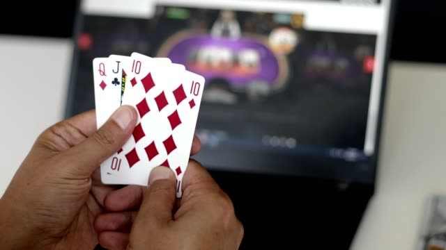 man showing poker hand of cards with poker table in laptop display - hand of cards stock videos & royalty-free footage
