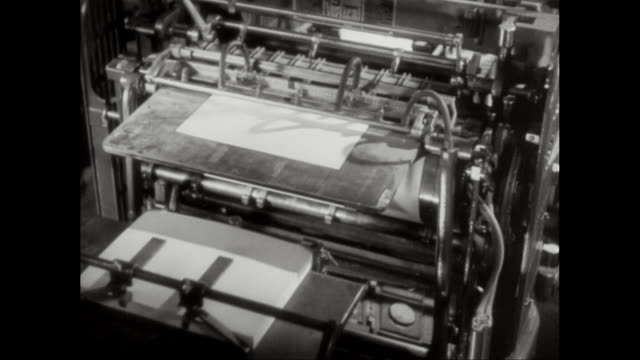 ms man showing printing paper, printing machinery operating in printing press / united states - 技能点の映像素材/bロール