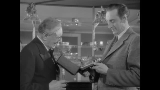1946 man shows sherlock holmes (basil rathbone) and doctor watson (nigel bruce) his music box collection - sherlock holmes stock videos & royalty-free footage