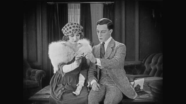 1920 Man (Buster Keaton) shows woman her engagement ring