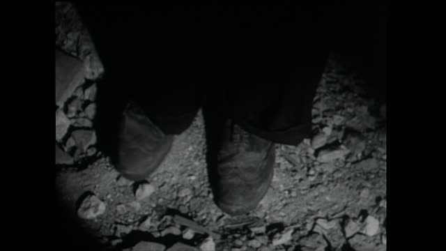 man shuffles feet nervously and kicks stones; 1955 - 1955 stock videos & royalty-free footage