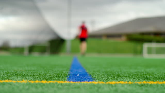 man shuttle runs on artificial turf - pitch stock videos & royalty-free footage