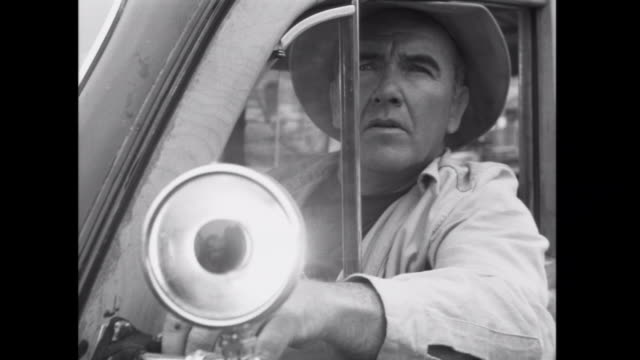1952 a man signals to a boat with his car light - suspicion stock videos & royalty-free footage