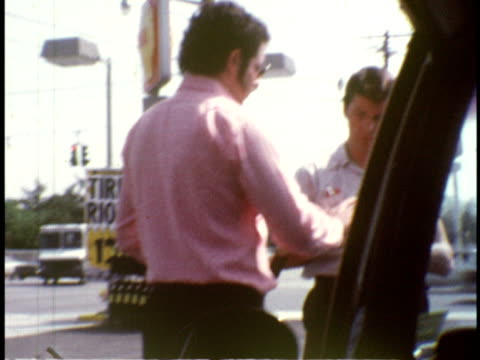 1974 ms man signing something at forecourt of gas station / hempstead, new york - 1974 stock videos and b-roll footage