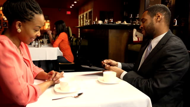 man signs bill in busy restaurant - dining stock videos & royalty-free footage