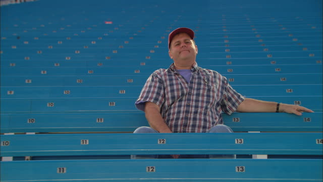 la ws pan man sitting alone with head in his hands in empty bleachers / homestead, fl, usa - miami dade county stock videos and b-roll footage