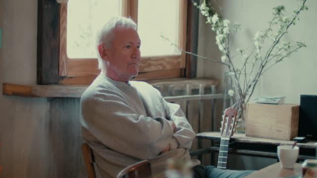 Man sitting at table, waiting