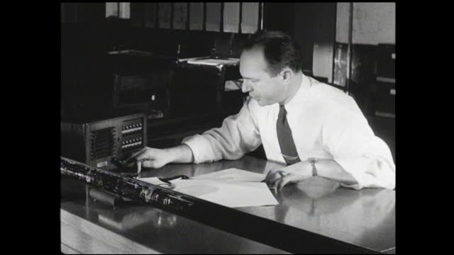 man sitting behind office desk making calls on the intercom unit - 1940 1949 stock videos & royalty-free footage